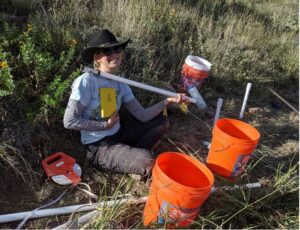 Graduate student Mariel Nelson completes a cluster of piezometers to measure groundwater flow at McDonald.